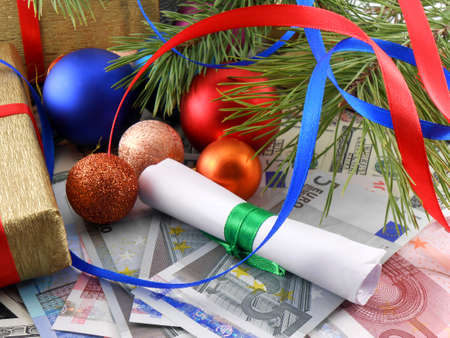 Decorated christmas tree with money, traditional new year holiday card photo
