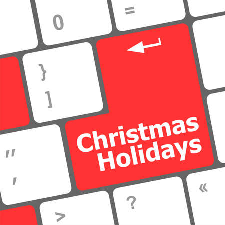 Computer keyboard key with christmas holidays words photo