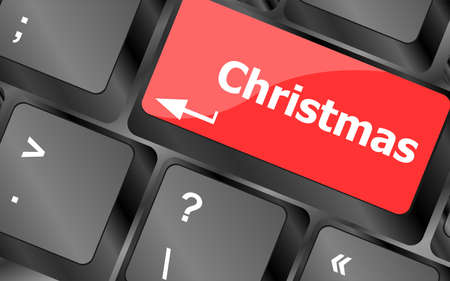 christmas button on the keyboard key - holiday concept photo