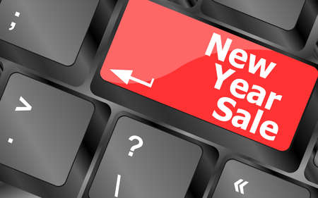Computer keyboard with holiday key - new year sale photo