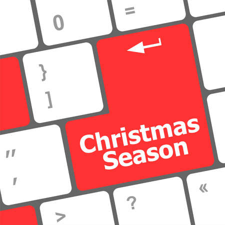 Computer keyboard key with christmas season words photo