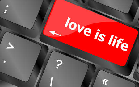 Modern keyboard with love is life text symbols photo