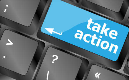Take action red key on a computer keyboard, business concept photo