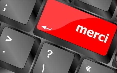 merci: merci word on computer keyboard key Stock Photo