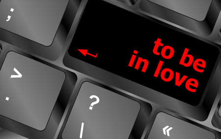 Modern keyboard key with words to be in love photo