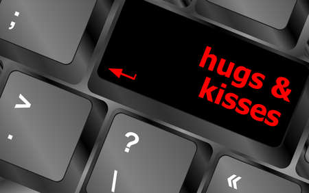 hugs and kisses words on computer keyboard keys photo