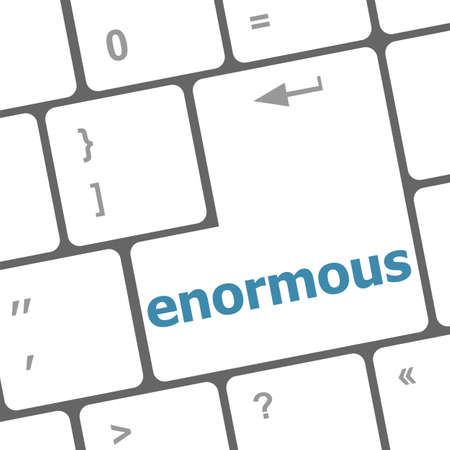 enormous: enormous word on keyboard key, notebook computer button Stock Photo