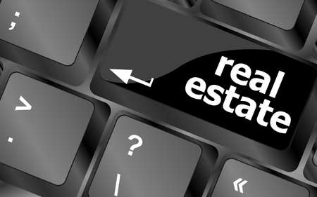 Real Estate concept. hot key on computer keyboard with Real Estate words photo