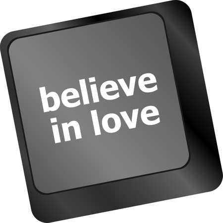 keyboard key with believe in love text and arrow photo