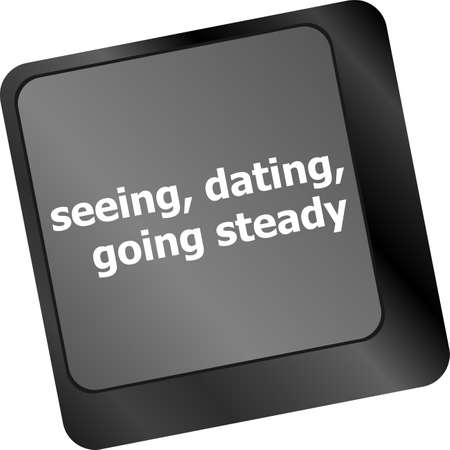 Modern keyboard with seeing, dating, going, steady text symbols photo