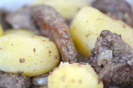 griller: Mixed grill on a plate, meat and potatoes