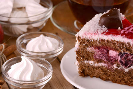 Chocolate Cake with tea cup and meringues photo