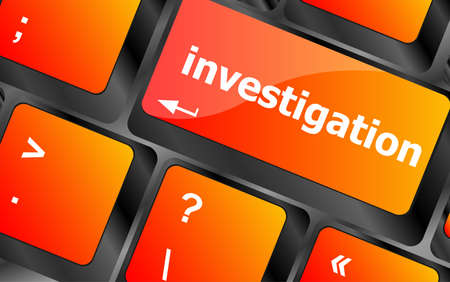 investigation - business concept. button on modern computer keyboard photo