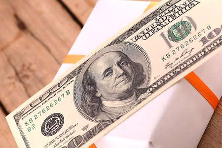 Holiday bonus.  american money on green gift box photo