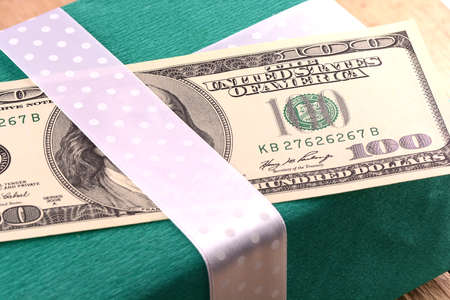 american money with green gift box photo