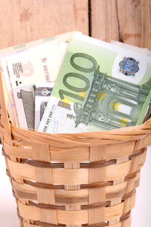 european money: european money on wooden basket