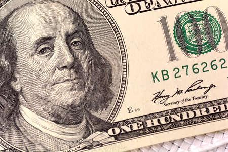 one hundred dollar bill: Dollars closeup. Benjamin Franklin portrait on one hundred dollar bill Stock Photo