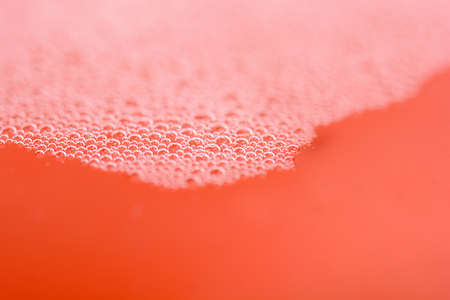 red in water: red water drops close up