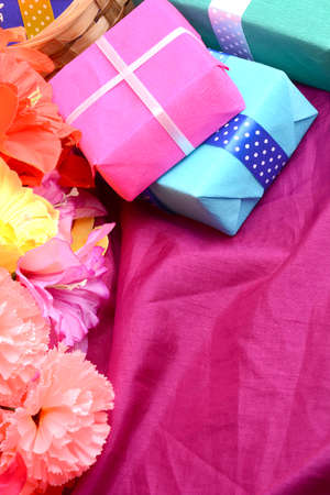 copy sapce: present gift box and flower bouquet on silk Stock Photo