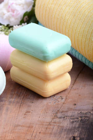 aroma therapy: towels set, aroma therapy, soap and sea salt on wooden plate