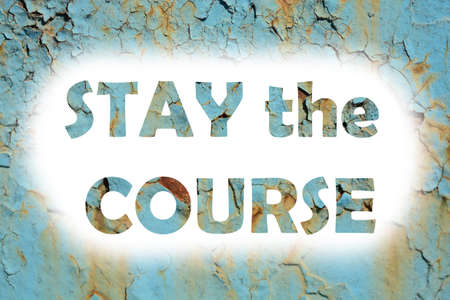 stay at the course: stay the course words print on the grunge metallic wall