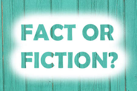 fact or fiction words print on the wooden plate Banco de Imagens