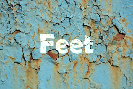 feet word print on the rusted metal corrugated metal background Stock Photo