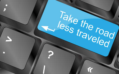 traveled: Take the road less traveled.  Computer keyboard keys. Inspirational motivational quote.