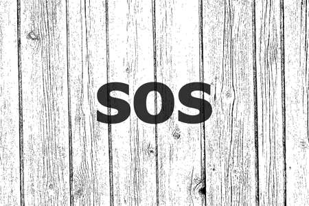 Text Sos. Social concept . Wooden texture background. Black and white
