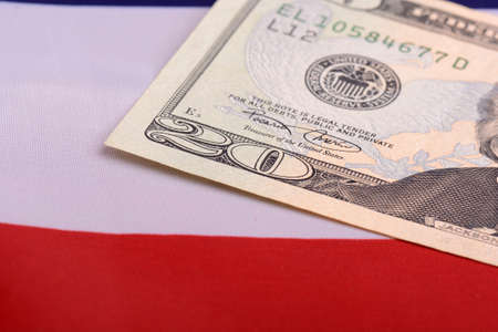 twenty dollar bill in front of the American flag 写真素材