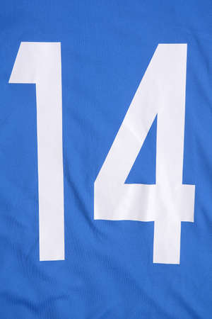blue football shirt with white number 14 on it. sports wear background.