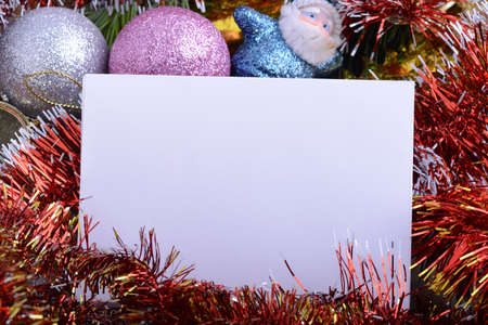 Merry Christmas and Happy New Year 2021 Holiday card. White paper and christmas greetings, ball set close up, christmas glitter confetti.
