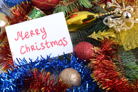 Merry Christmas and Happy New Year Holiday card. White paper and christmas greetings, balls set close up, 2021 christmas glitter confetti.
