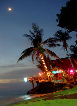Night shot of the beach barrestaurant on the west coast of Koh Chang island . The place name is White Sand.