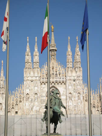 famous gothic cathedral in Milan in Italy. 3 flags-vatican,italian, european.