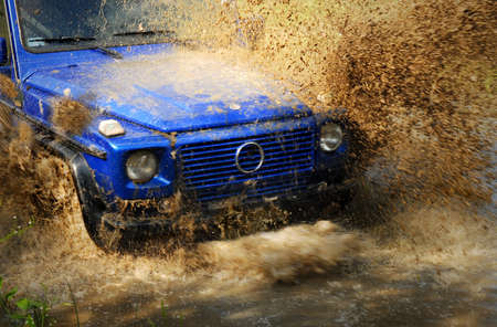 Off-road car crossing deep mud Stock Photo