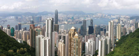 View from Victoria Peak. Financial district on first plan and over the bay Kowloon. Very wide wiew.