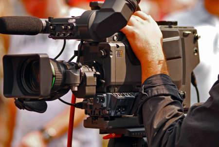 TV transmission on line. Proffesional video camera. Shot done on the street. Stock Photo