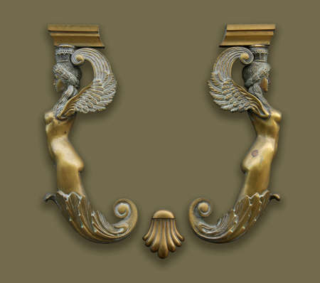 greek mythology: antique bronze decoration. Two ladies. Space for logo between them. Stock Photo