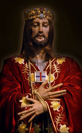 Jesus wooden medieval sculpture. Dressed up with clothes. Probably Spanish artist made this masterpiece.