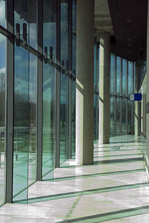 Modern office park interior. Glass wall and cement pillars. Polish Olimpic Comitee building.