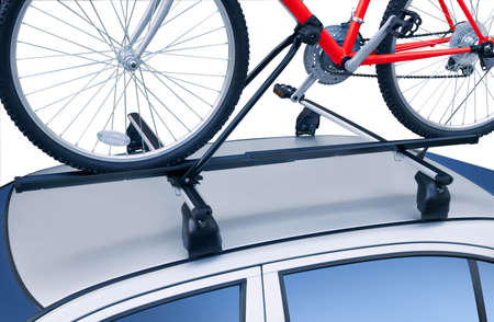 Roof rack with bicycle on. Isolated on white.