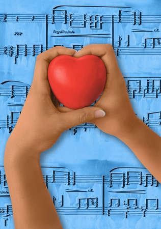 Girl hands holding red heart shape. Musical notes as background. Path for hands and hearth, Stock Photo