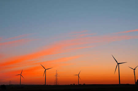 Wind electric power plant on sunset sky