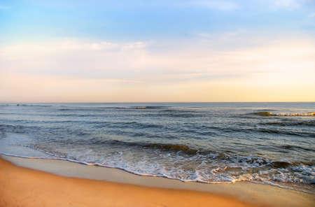 Morning sky, sandy beach and silent sea. Stock Photo