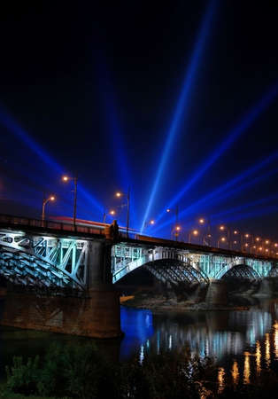 Event stream lights on other side of the river.  Stock Photo