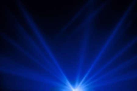 Night sky illuminated by projectors  Stock Photo