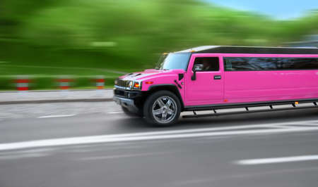 Long pink hummer limousine in the movement.