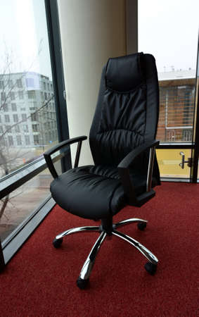 Leather armchair standing near window in the office. Stock Photo - 9180739