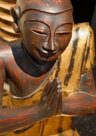 Tibetan wooden praying sculpture photo
